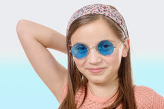 Portrait of a young girl with a scarf in the hair, hippie style Stock Photos