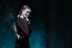 Portrait of a young girl in school uniform as killer woman Stock Photo