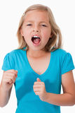Portrait of a young girl screaming. Against a white background Royalty Free Stock Photos