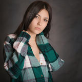 Portrait of a young girl in shirt. Stock Images