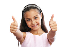 Portrait of young girl showing a thumbs up Royalty Free Stock Images