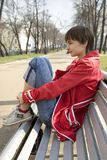 Portrait of young girl sitting on the bench Royalty Free Stock Photo