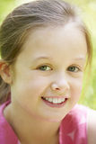 Portrait Of Young Girl Sitting In Field Royalty Free Stock Photography