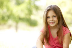 Portrait Of Young Girl Sitting In Park Royalty Free Stock Images