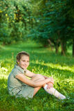Portrait Of Young Girl Sitting In Park Royalty Free Stock Photo