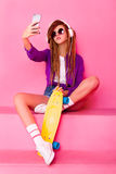 Portrait of a young girl with skateboard Royalty Free Stock Images