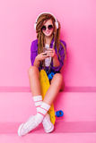 Portrait of a young girl with skateboard Royalty Free Stock Image
