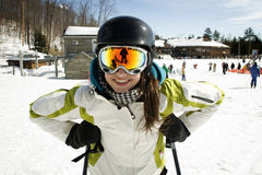 Portrait of young girl with ski poles Stock Photography