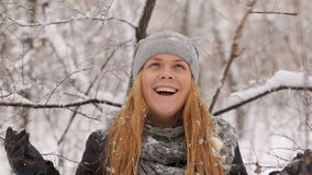 Portrait of a young girl in a snowy forest. stock video footage