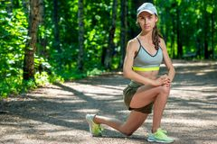portrait of a young girl with a sports figure performs exercises in a summer royalty free stock photos
