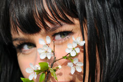 Beautiful girl in spring blooming garden Stock Photos
