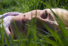 Portrait of a young girl. Spring in nature in the grass Stock Photo
