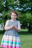 Portrait of Young Girl Standing in Backyard Royalty Free Stock Photography