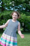 Portrait of Young Girl Standing in Backyard Stock Photography