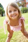 Portrait Of Young Girl Standing In Garden Stock Photos