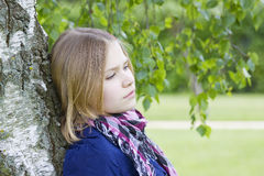 Portrait of young girl standing near birch tree Stock Photos
