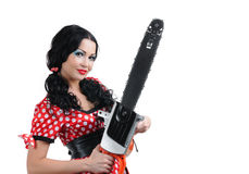Portrait young girl in style pinup with electric saw Royalty Free Stock Image