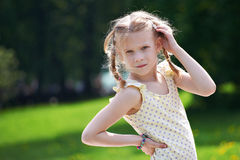 Portrait of young girl on summer sunny landscape Stock Images