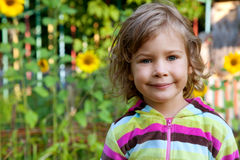Portrait of young girl with sunflowers Stock Photo