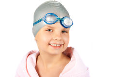 Portrait of a young girl in swimming cap. Portrait of a young girl in goggles and swimming cap. Isolated royalty free stock images