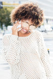 Portrait of young girl talking by mobile phone. Stock Photo