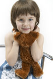 Portrait of young girl with a teddy. Portrait of girl with a teddy royalty free stock image