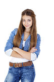 Portrait of a young girl teenager in jeans jacket and blue jeans Royalty Free Stock Images