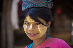 Portrait young girl with thanaka on face. Mrauk U, Myanmar Stock Photography