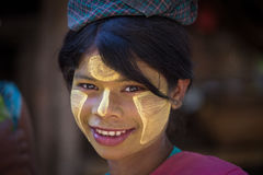 Portrait young girl with thanaka on face. Mrauk U, Myanmar Stock Photography