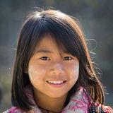 Portrait young girl with thanaka on her smile face. Inle lake, Myanmar Stock Image