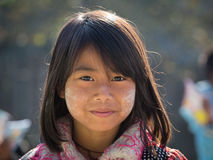 Portrait young girl with thanaka on her smile face. Inle lake, Myanmar Stock Photography