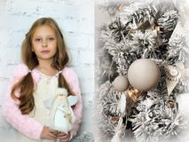 Portrait of  girl with a toy angel in her hands Stock Images