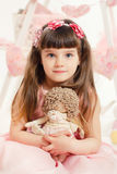 Portrait of young girl with a toy in the hands of Stock Images