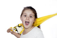 Portrait of the young girl with a umbrella on a white background. Portrait of the girl with the dismissed hair and with a yellow umbrella Royalty Free Stock Photography