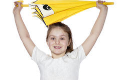 Portrait of the young girl with a umbrella on a white background. Portrait of the girl with the dismissed hair and with a yellow umbrella Stock Photos