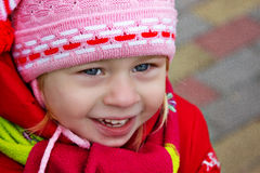Portrait of a young girl in a warm winter clothing Royalty Free Stock Image