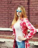 Portrait young girl wearing a checkered shirt and sunglasses Royalty Free Stock Photos