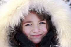 Portrait of young girl wearing fur lined Royalty Free Stock Photo