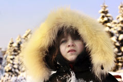 Portrait of young girl wearing fur lined coat Royalty Free Stock Photo
