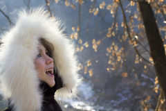 Portrait of young girl wearing fur lined coat hood Stock Photos