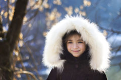 Portrait of young girl wearing fur lined coat hood Stock Photo
