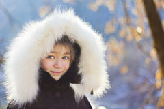Portrait of young girl wearing fur lined coat hood Royalty Free Stock Photo