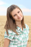 Portrait of the young girl in the wheat field Stock Photo