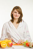 Portrait of a young girl who cuts vegetables for salads Royalty Free Stock Photos