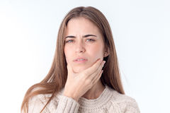 Portrait of a young girl who feels like toothache close-up Royalty Free Stock Images