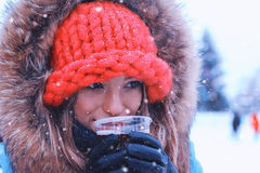 Portrait of a young girl in the winter drink wine royalty free stock images