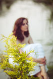 Portrait of young girl woman with cedar arborvitae royalty free stock images