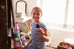 Portrait Of Young Girl Working On Painting In Studio Stock Photography