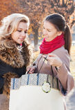 Portrait of a young girlfriends with shopping Stock Photos