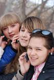 Portrait of the young girls. Portrait of the young girl with a phone royalty free stock photography